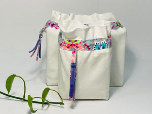 Two bags in off-white cotton with a Butterfly trim. One bag is big and one small