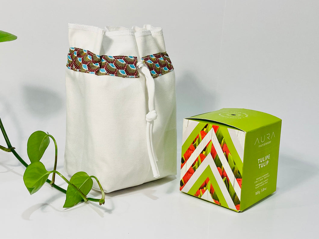 One small bag in off-white cotton canvas with a Peacock trim next to a small box
