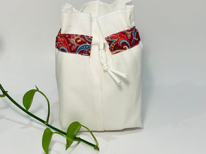 One small bag in off-white cotton canvas with a Red Paisley trim