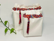 Load image into Gallery viewer, Two bags in off-white cotton with a Red Paisley trim. One bag is big and one small.