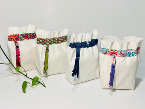 Four bags in off-white cotton canvas with four different trims
