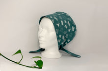 Load image into Gallery viewer, Left side view of Women cotton scrub cap Whit Cactus Pattern printed on Green