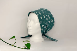 Left side view of Women cotton scrub cap Whit Cactus Pattern printed on Green