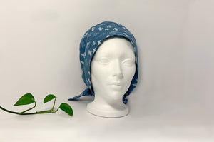 Front view of Women cotton scrub cap Whit Cactus Pattern printed on Blue