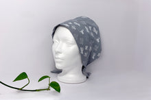Load image into Gallery viewer, Left side view of Women cotton scrub cap Whit Cactus Pattern printed on Grey
