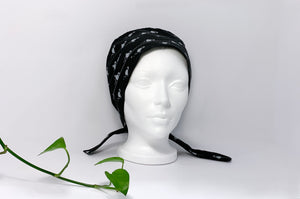 Front view of Scrub Cap with White Flamingo print on Black ground