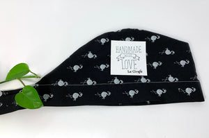 Folded Scrub Cap with White Flamingo print on Black ground