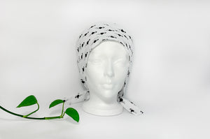 Front view of Scrub Cap with Black Flamingo print on White ground