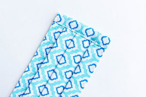 Closeup of Pleated face mask in Aqua printed pattern