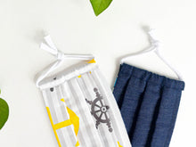 Load image into Gallery viewer, Two face masks one with Yellow Anchor and Grey stripes print, one in Blue Denim fabric