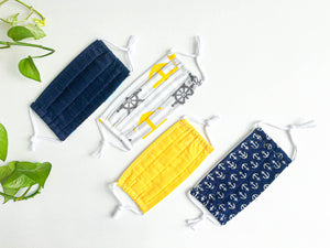 Four face mask with various Navy and Yellow prints and colours