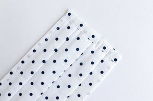 Closeup of face mask Black Polka Dots on White