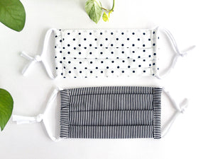 Two face masks one Black Polka Dots on White one Black and White Stripes