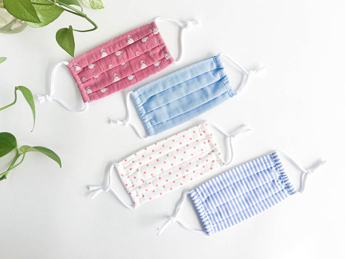 Four face masks one Pink Flamingo one Solid Blue one Pink Polka dots one Blue and White stripes
