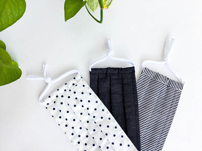 Close up of Three face masks of Black and White Polka Dots Stripes and Denim