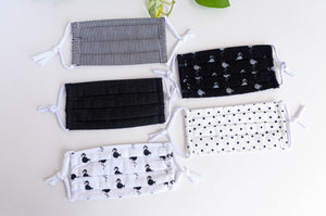 Five face mask in assorted colours and prints all Black and White