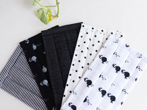 Closeup of Five face mask in assorted colours and prints all Black and White