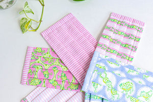 Closeup of six face mask of 2 Pink Stripes and 4 Frogs prints