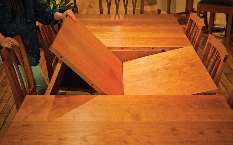BUTTERFLY EXTENDING DINING TABLE