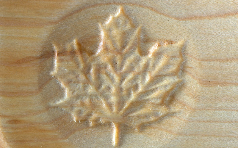 PLAIN MAPLE BREADBOARD WITH CARVED LEAF