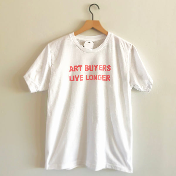 "White Unisex T-shirt with pink flocked lettering ""ART BUYERS LIVE LONGER"""