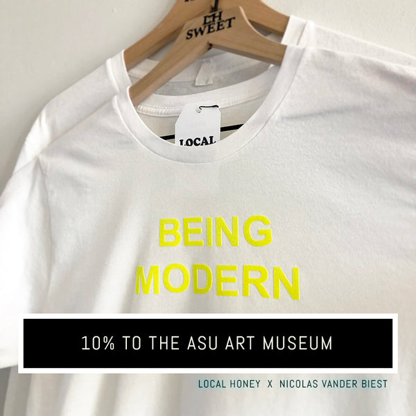 "White Unisex T-shirt with yellow flocked lettering ""BE MODERN"". Local Honey x Nicolas Vander Biest collaboration. 10% donated to the ASU Art Museum."
