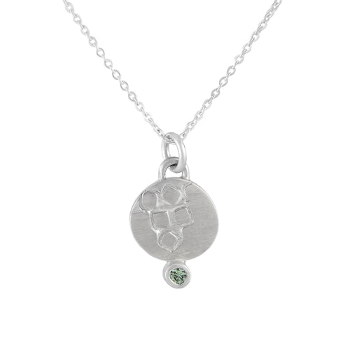 Delicate round, textured silver pendant with 2mm green sapphire | Imprint Collection | Margo Orlovik