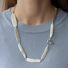 Load image into Gallery viewer, PARAGON ACME II 22 inches silver necklace with clasp visible on a model | Margo Orlovik IMPRINT Collection Contemporary Jewellery