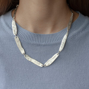 PARAGON ACME I 19 inches silver necklace on a model | Margo Orlovik IMPRINT Collection Contemporary Jewellery