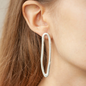 PARAGON DART silver mismatched earrings ON A MODEL | Margo Orlovik IMPRINT Collection Contemporary Jewellery