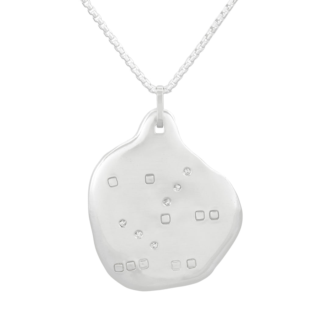 Organic shaped silver pendant with square pattern and white sapphires, on a chain.