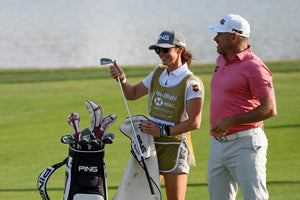 Lee Westwood wearing a Druh Golf Belt and Helen Storey his fiance and now caddie on the bag. playing golf