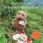Load image into Gallery viewer, Celestine and the Hare Gift Set - 'Bertram Likes to Sew' Story Book and Polar Bear Colours Felting Pack