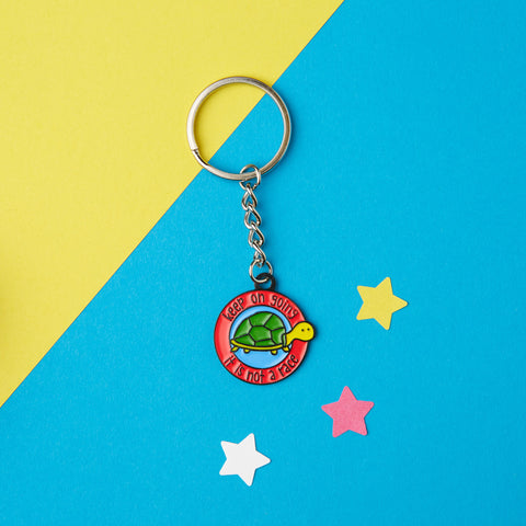 Keep going enamel keyring