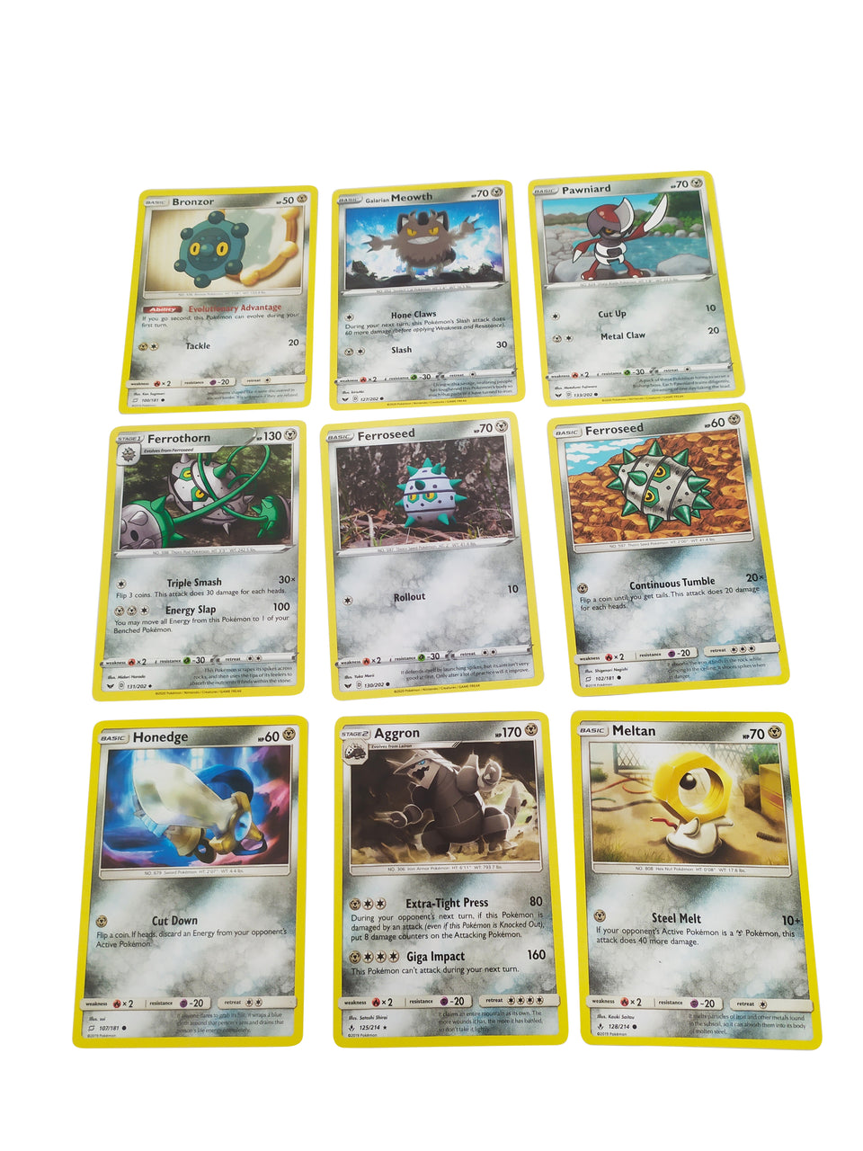 9 lot of pokemon cards  - included : Bronzor , Ferrothorn , Honedge , Aggron , Ferroseed , Meowth , Pawniard , Ferroseed , Meltan