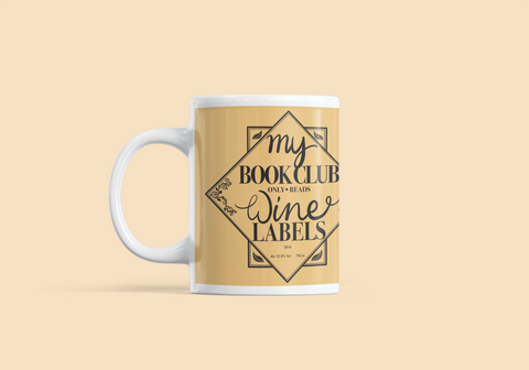 white mug with yellow design 'my book club only read wine labels'