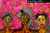 3 Black feminine figures with natural hair. In front of pink background with gold leaves.