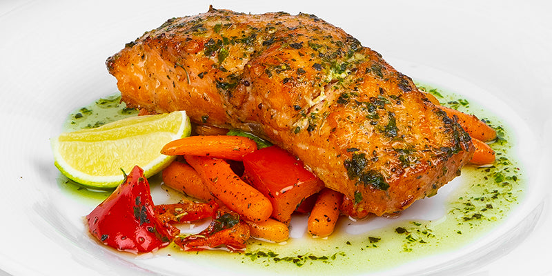 Baked salmon pesto with carrots, lime, and peppers