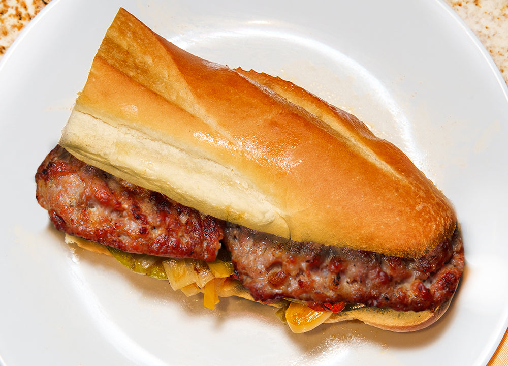 Italian street food panino con salamella pork sausage sandwich with roasted peppers and onions