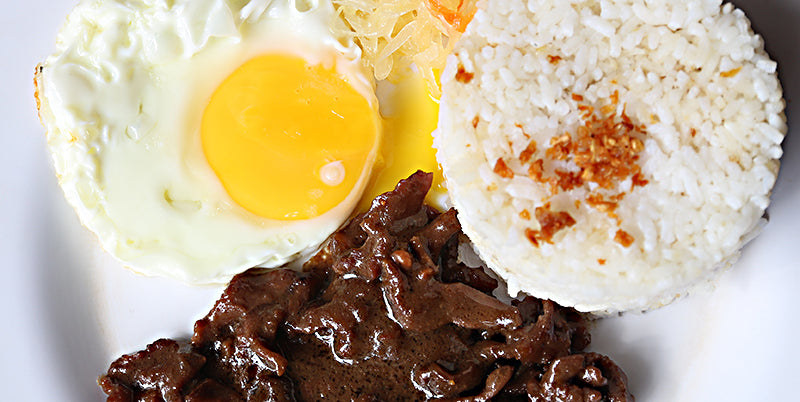 Filipino Breakfast with Egg, Garlic Fried Rice, and Marinated Beef