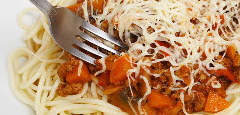 Spaghetti with sauce and cheese, a fork spinning it