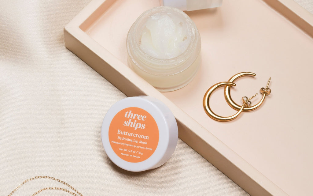 Buttercream Hydrating Lip Mask on nightstand with jewelry