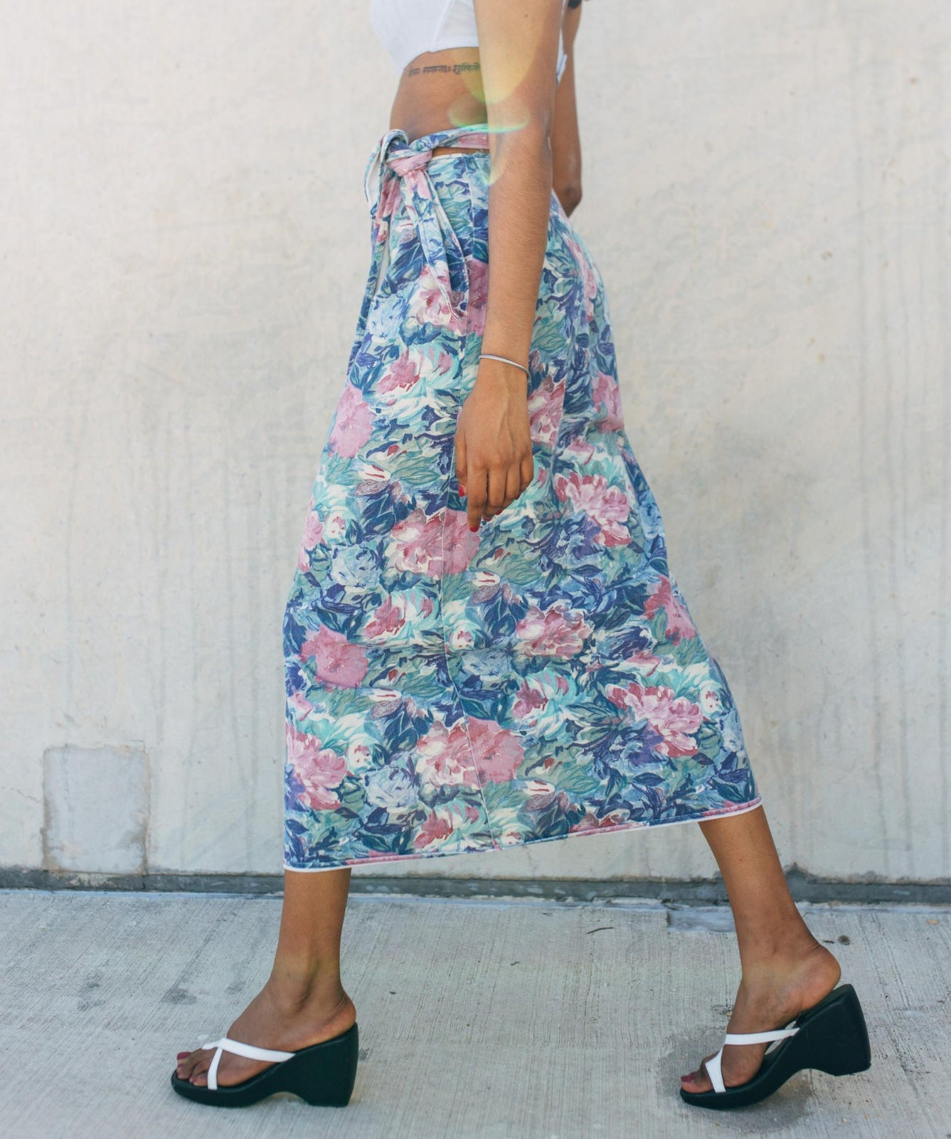 vintage floral wrap skirt on a model facing sideways