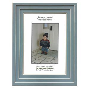 Handcrafted sky blue colored photo frame with linear white accents