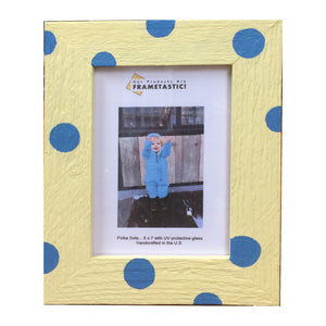 Photo frame handcrafted from reclaimed barn wood painted yellow and adorned with blue polka dots