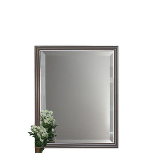 Cocoa brown beveled mirror with stepped moulding has clean white lines