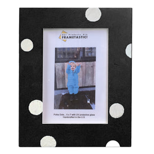Photo frame handcrafted from reclaimed barn wood painted black and adorned with white polka dots