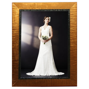 Contemporary, high style copper colored photo frames. Great for wedding and other formal pictures