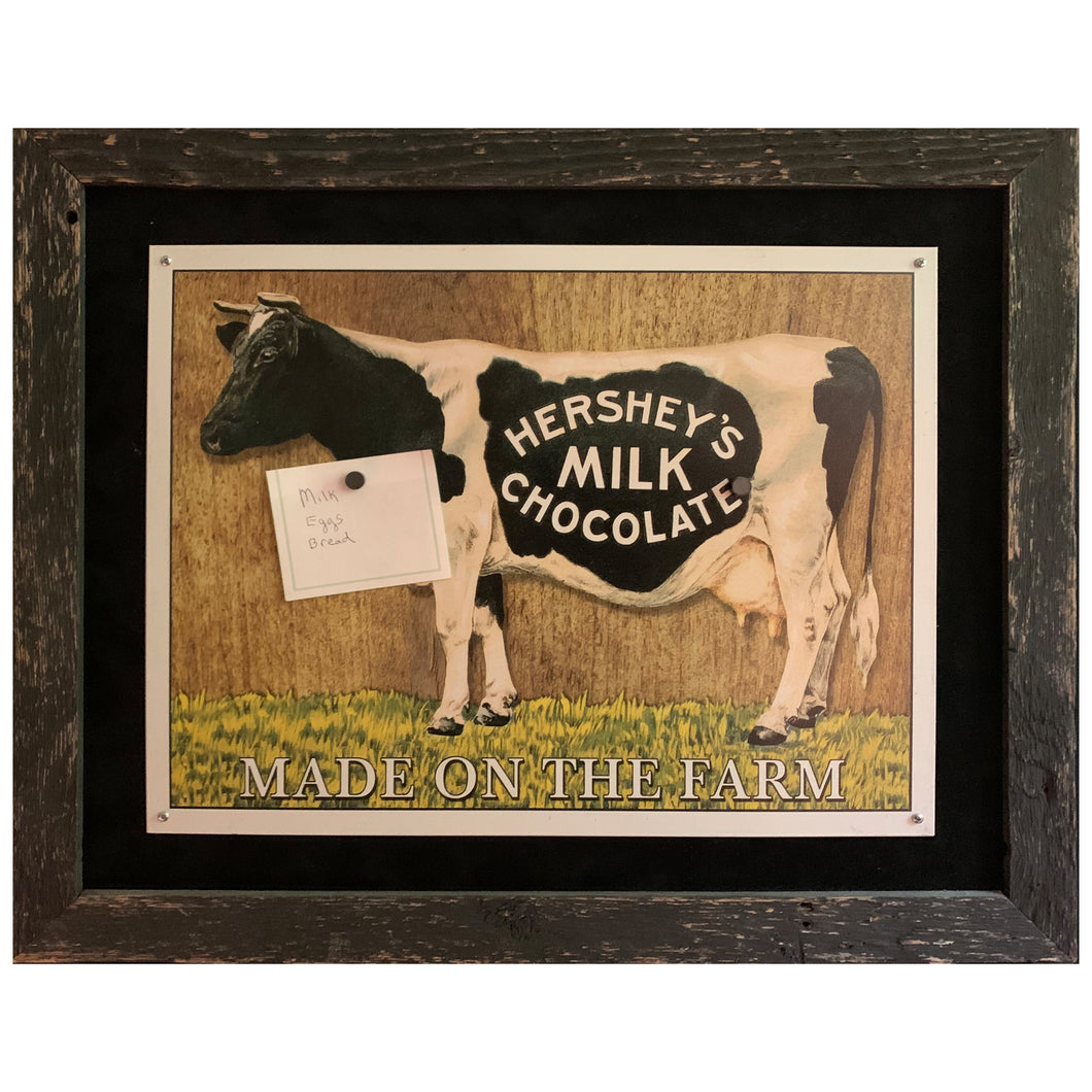Magnet board featuring Hershey cow on black background with black barnwood frame