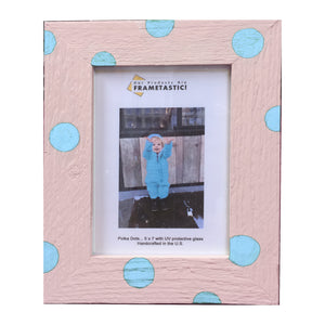 Photo frame handcrafted from reclaimed barn wood painted pink and adorned with light blue polka dots